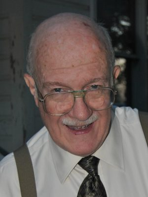 ROBERT E. WILKINS